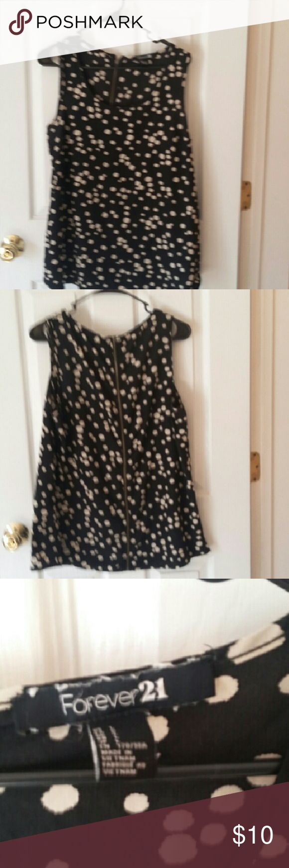 "Forever 21 sleeveless blouse. Forever 21, sleeveless blouse. Black with white  ""splotches"". Zipper down the back. Polyester.  EUC. Size Large.  Smoke-free home. Forever 21 Tops Blouses"
