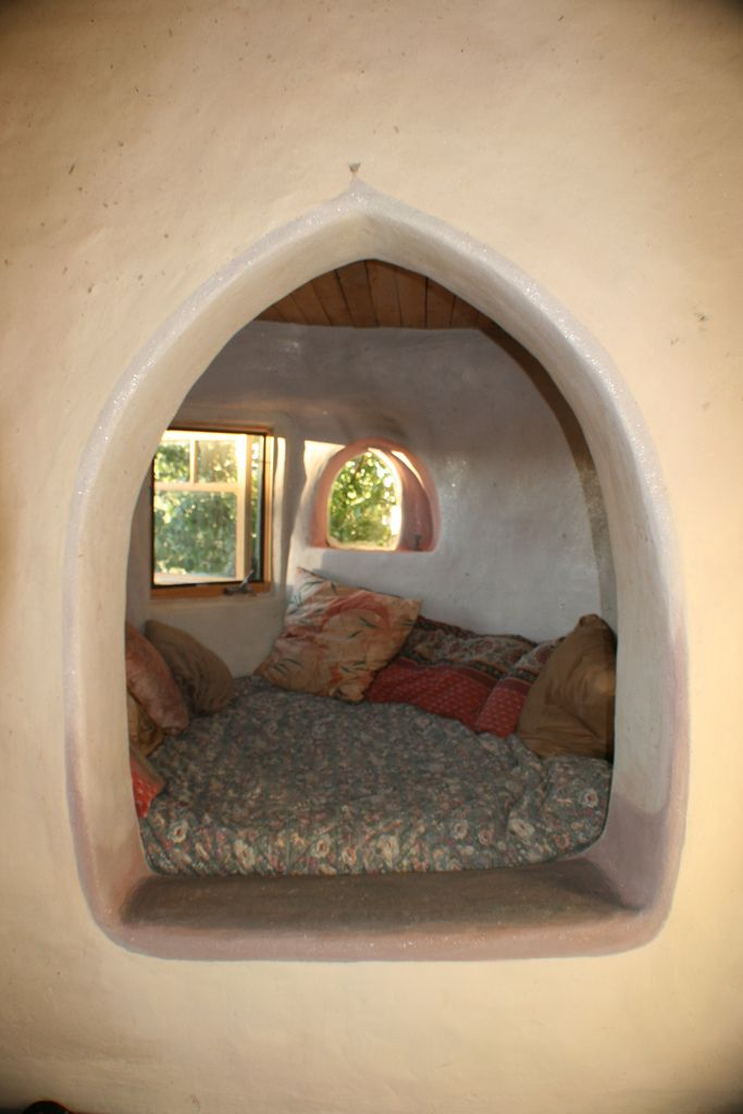 Cob house must-haves:  reading and meditation nooks (I'd totally paint this like a tree - so you can feel like you're climbing into the trunk :)