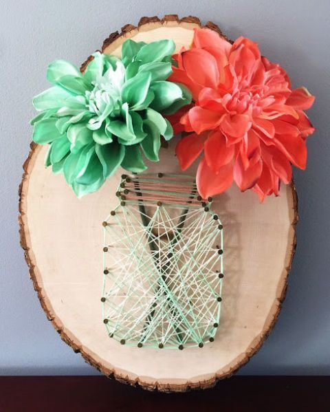 "Just try and tell us you've seen a craft cuter than this! Turn a wood slice into a ""mason jar vase"" with some nails, string, and faux flowers.   Get the tutorial at Dear Paradise."