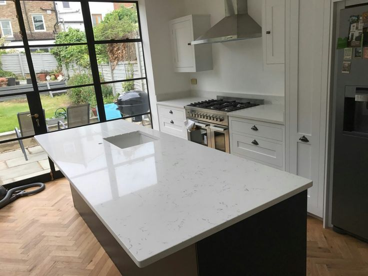 This is the Carrera. It is a pure white style quartz with grey marbling throughout.