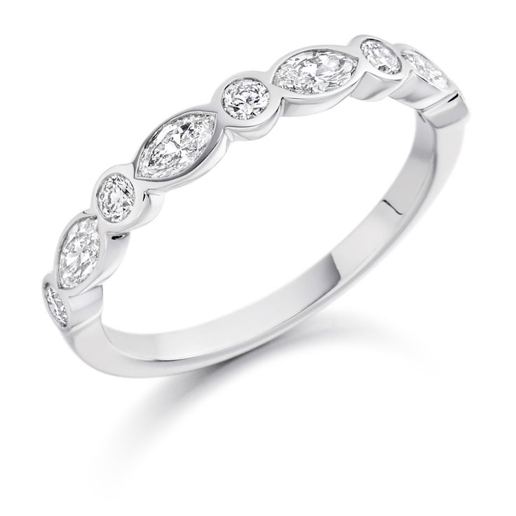 A stunning combination of 0.60ct Round Brilliant Cut & Marquis Cut Diamonds, rubover set in a beautiful band.  This piece is available in 9ct – 18ct Gold, Palladium & Platinum  Prices shown are for Clarity G+Si1 as standard  Available in Colour Grade D to G and Clarity Grade VS1 to Si1.  To Specify a Certain Colour and Clarity Grade, Please Contact us.    Diamond Weight: 0.60ct   Diamond Cut: Round Brilliant & Marquis   Diamond Clarity Availability: F/G VS, G+ Si1 and H+ Si2 ...