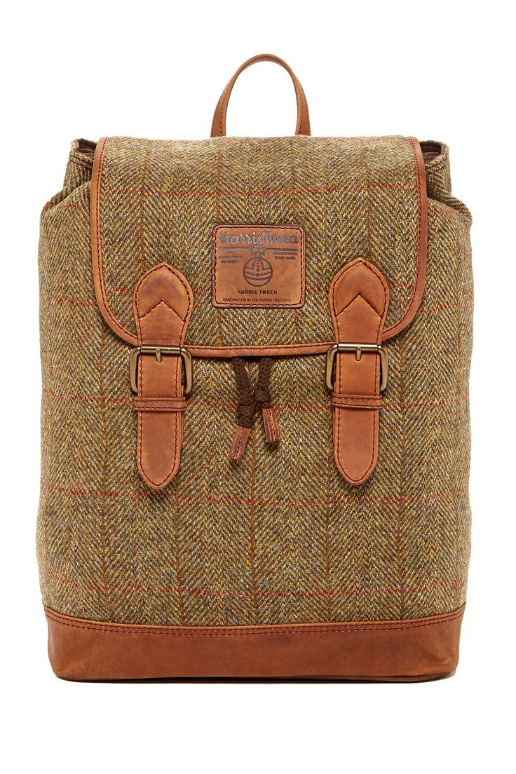 """Highland Harris Tweed Large Rucksack in green check by British Belt Co. $300 - $99 @HauteLook. - Single top handle with adjustable shoulder straps - Foldover front flap with magnetic closures and buckle strap detail - Drawstring closure under flap - Exterior features allover tweed with leather trim - Interior features zip wall pocket and allover padding - Approx. 17.25"""" H x 13"""" W x 5.25"""" D - Approx. 4.5"""" handle drop, 8.5-15"""" strap drop - Wool and leather exterior, cotton lining"""