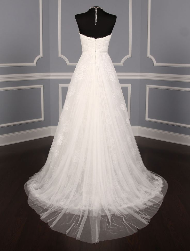 This Monique Lhuillier Sugar wedding dress is absolutely gorgeous! Both the Spanish tulle and the lace are very luxurious. You will look amazing as you walk down the aisle in this wedding gown. #weddingdress