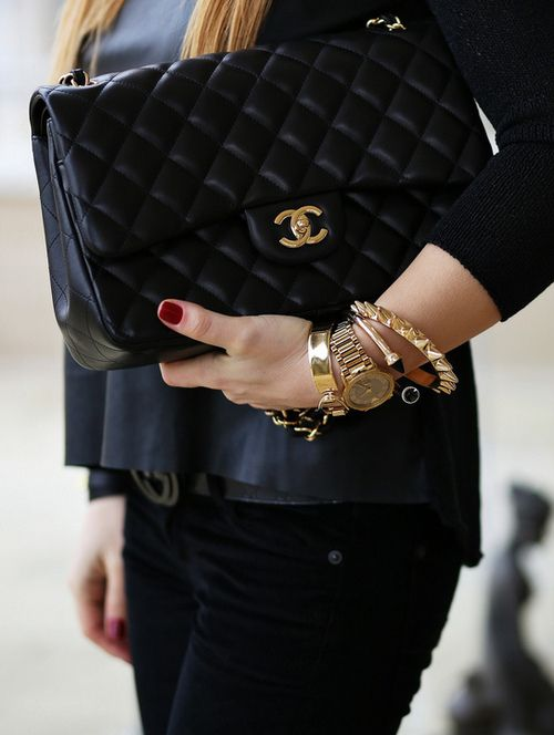 I see an Arm Party - I can do this look for much much Less - btw love the bag also: