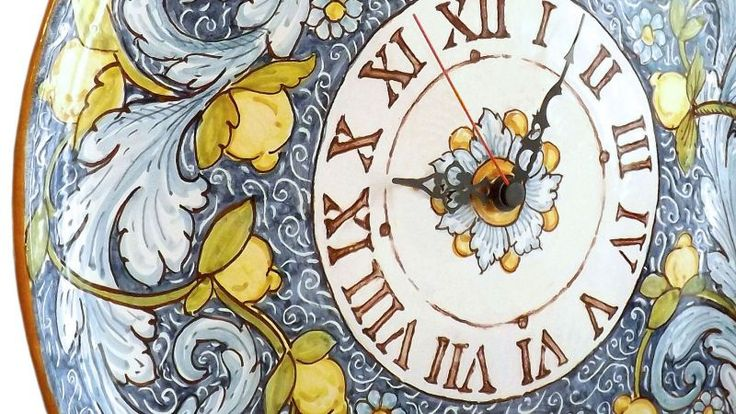 Wall Clock. Wall clock with floral decoration and small lemons on a blue background.