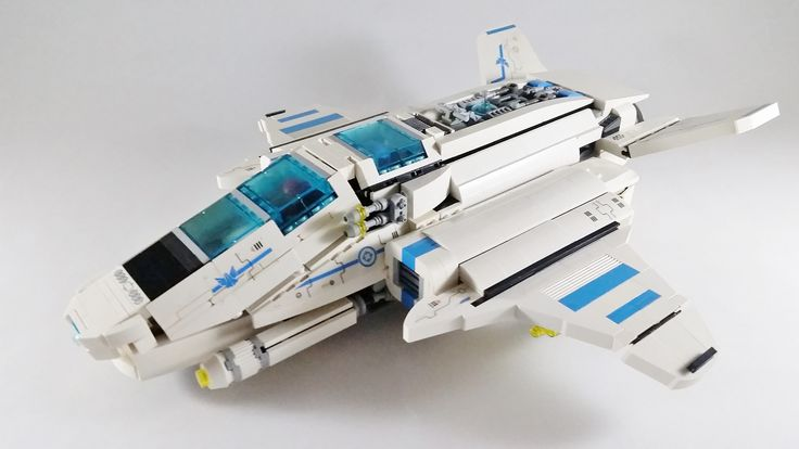 https://flic.kr/p/LJE9QE | GR-705 (Back Story & Build Notes) | The GR-705 is the Galaxy Regiment's long range bomber.  In addition to the varied payload the 705 can take under-wing, it has two powerful forward blasters that can disable most ships on a few hits.  But the GR-705 wasn't made just to hit hard, it was made to have a successful mission and get back home.  It has two separate engine type.  Two pairs of normal burners for regular flight and combat and a pair of high output engines…