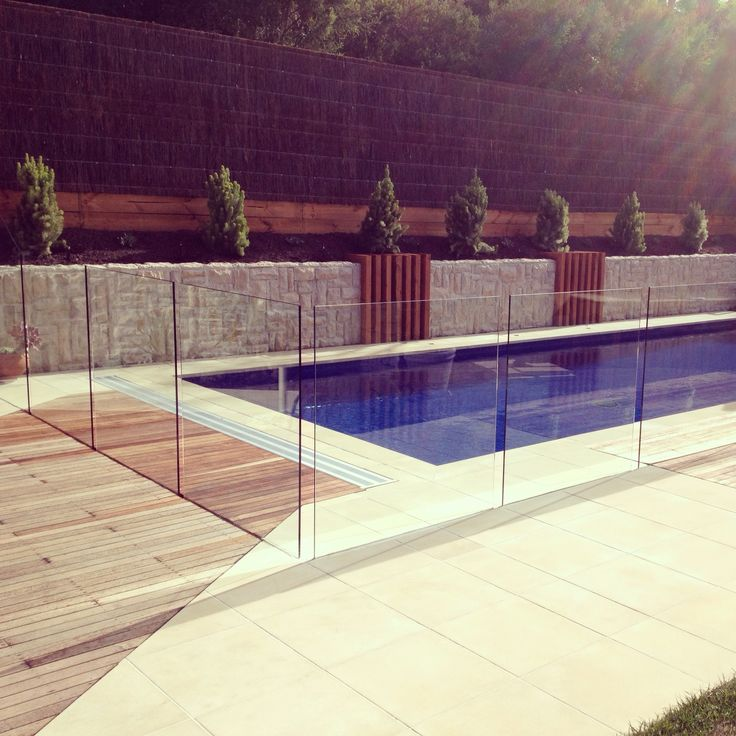 Nice pool for summer. Stone wall, decking and paving