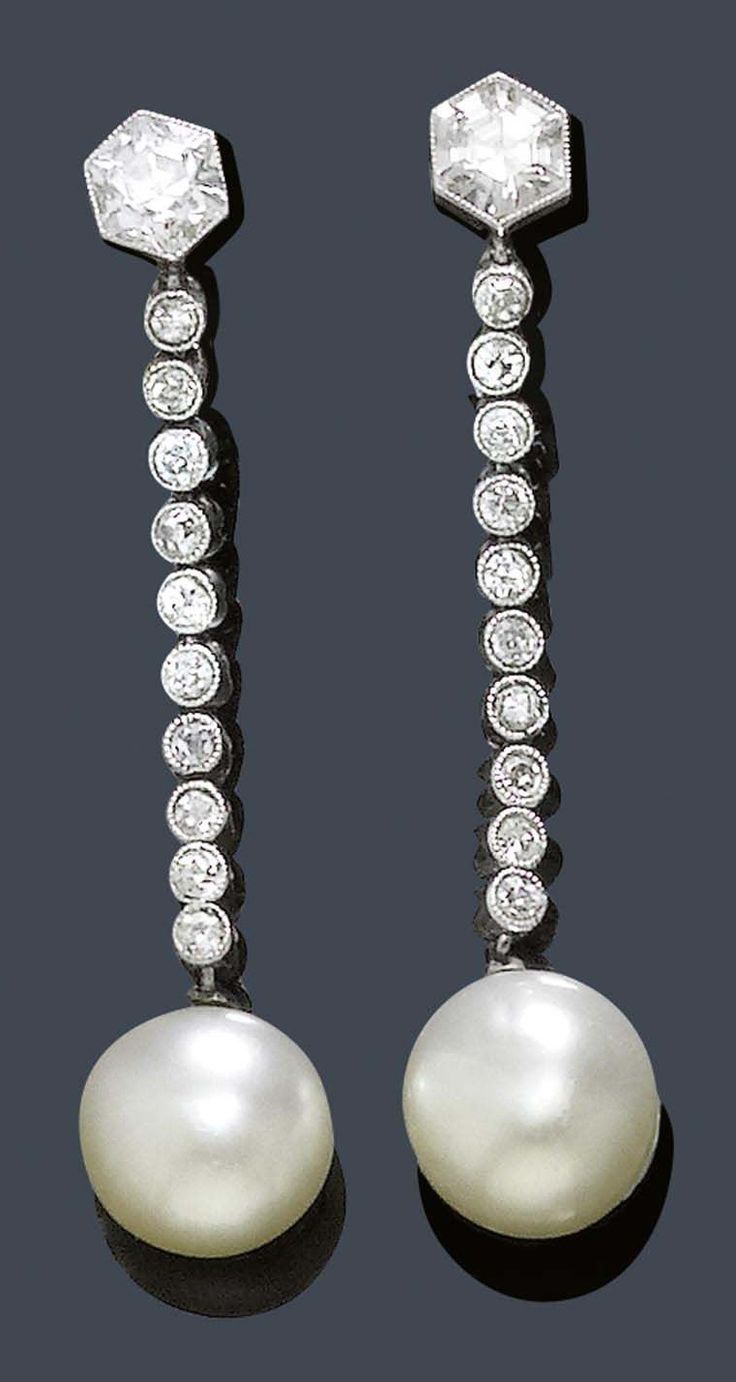 "BOUCHERON - AN ELEGANT PAIR OF ANTIQUE PLATINUM, PEARL AND DIAMOND EAR PENDANTS, PARIS, CIRCA 1900. Each composed of one button-shape natural pearl, suspended from an articulated line of 10 single-cut diamonds, surmounted by a hexagonal diamond. With French platinum mark, signed Boucheron Paris, monogrammed ""FB"" for Frédéric Boucheron. Length 3.5cm. #Boucheron #antique #earrings"