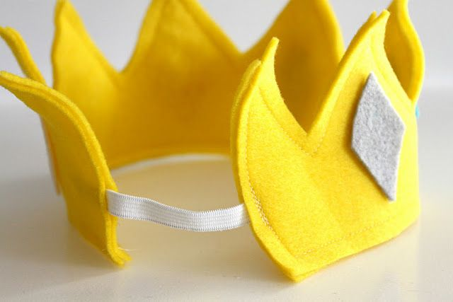I don't know why I never thought of sewing elastic to the back of a crown. Great idea!