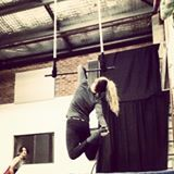 Elbow hangs on trapeze