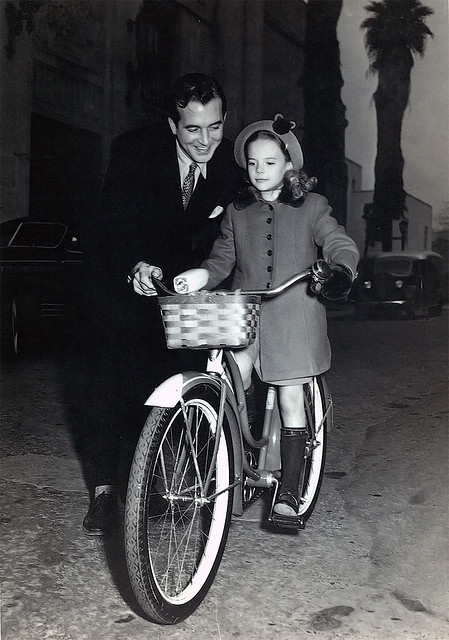 "John Payne and Natalie Wood (child actress!) behind the scenes of the movie ""Miracle on 34th Street"""