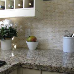 Santa Cecilia Granite. I love this backsplash.