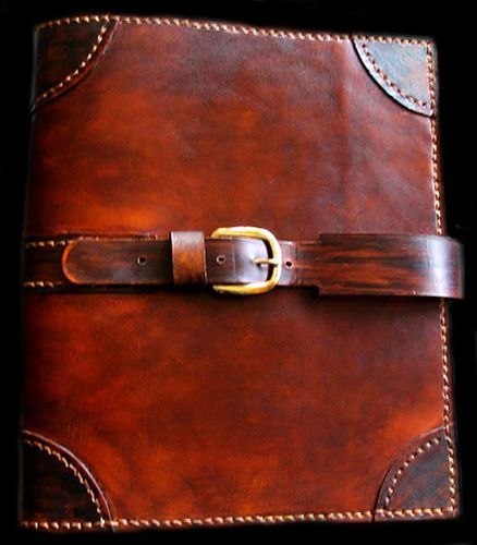 Leather, three ring, pockets, a double slide closure or buckle clasp Taylormade Leather 3-Ring Binder Gallery  http://www.taylormadeleather.com/3rings_gallery.html