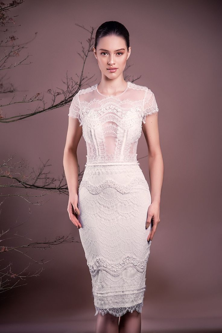 CRISTALLINI SKA563 - A game of embroidery, handmade, unique, transparent Chantilly lace. Ultra feminine and striking, bodycon dress is a style statement.  French Chantilly lace bust, 100% Italian tulle 100% polyamide Embroidered pencil skirt, partially lined, crepe lining for added comfort, waistband, open back, back slit for ease of movement Midi length Hidden YKK back zip, hook and fastening, Swarovski buttons Incorporated push-up bra cups for support Dry clean For a personalised t...