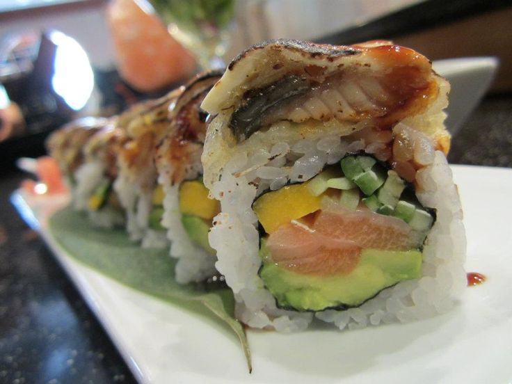 KAMEI KISS package!  Oda Roll, a bold and unique roll with mango, avocado, cucumber and salon. Tempura fresh water eel and cream cheese on top are torched before your eyes!     www.vaneats.ca