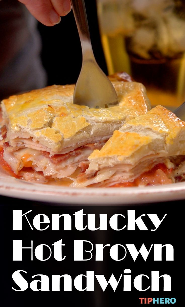 Kentucky Hot Brown Sandwich Recipe| If you haven't tried this hot sandwich, you don't know what you are missing. It's claim to fame is layers of warm turkey and bacon baked between layers of pizza dough and loaded with cheese and tomato to boot. Click for the video and recipe. #hotsandwiches #lunchideas #dinnerideas #familydinner
