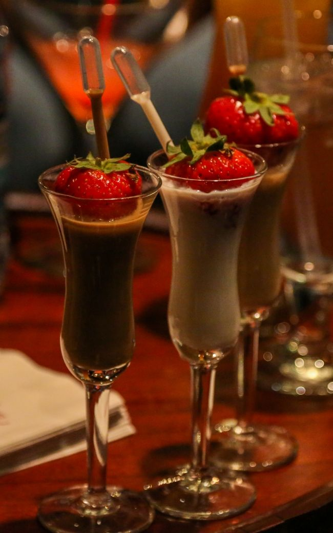 The Godiva Liqueur Flight – Three half-ounce pours of Godiva Liqueur: Chocolate, White Chocolate and Caramel topped with Godiva liqueur-infused strawberries