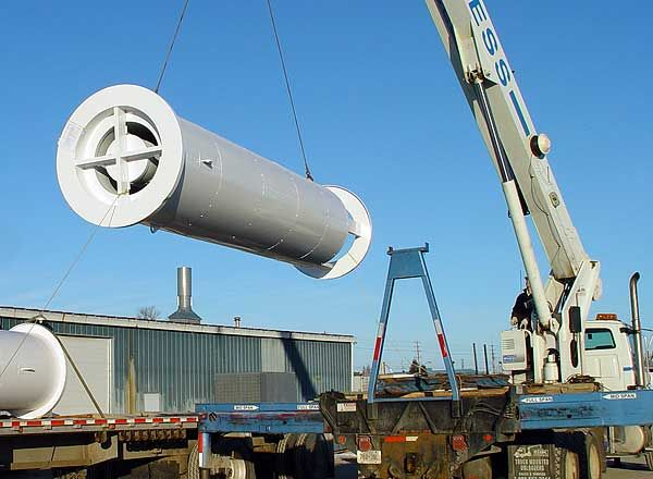 Circular Engine Muffler Being Loaded on a Truck by a Crane - dB Noise Reduction