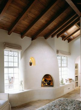 I do like the Santa Fe / Southwest style. Softly rounded adobe feel, with the rich wood above. And I especially like the skylights.