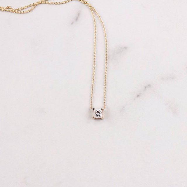 the gift that will wow   stunning .4Karat princess cut diamond set on a 14K yellow gold chain