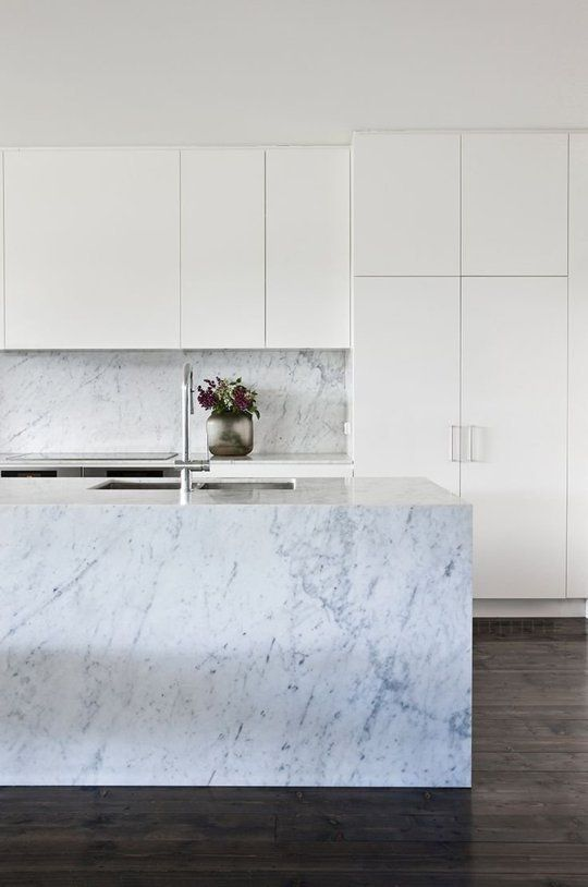 Calacatta marble gives this kitchen by Fiona Lynch just the right amount of luxe. | A Gallery of Minimalist Kitchens