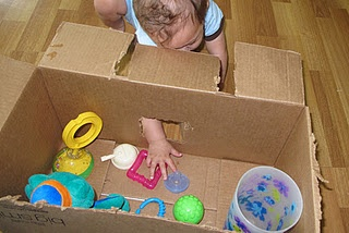 Place some objects that will fit through the hole and others that won't.  Baby can reach in and try to get objects out.  Their brains will try to figure out what's in there and how to get it out.