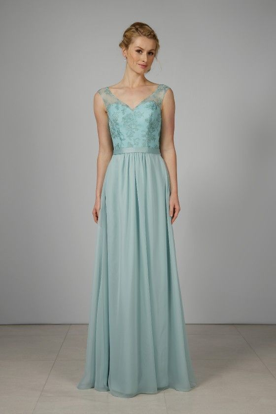 f6b41aed238 This elegant chiffon bridesmaid gown has a fitted bodice with a sweetheart  neckline and deep V