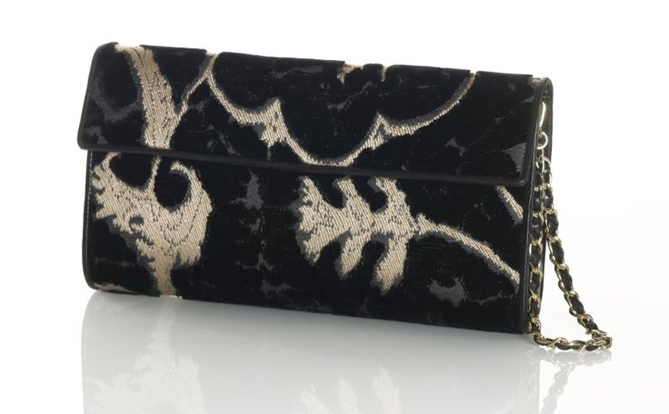 """The smallest and chicest bag of the moment gets a touch of Venice and is named after one of the typical boats of the Venetian lagoon: the balotina, a lesser known version of gondolas hardly used today. And so BALOTINA clutch bag was born, made of silky jacquard """"Gotico"""" velvet, it has the same determined spirit as the boat it owes its name to, thanks to the leather coverings on the inside and on its sides and to the metal and leather handle. Design and concept @ Chiara Pizzinato Atelier"""