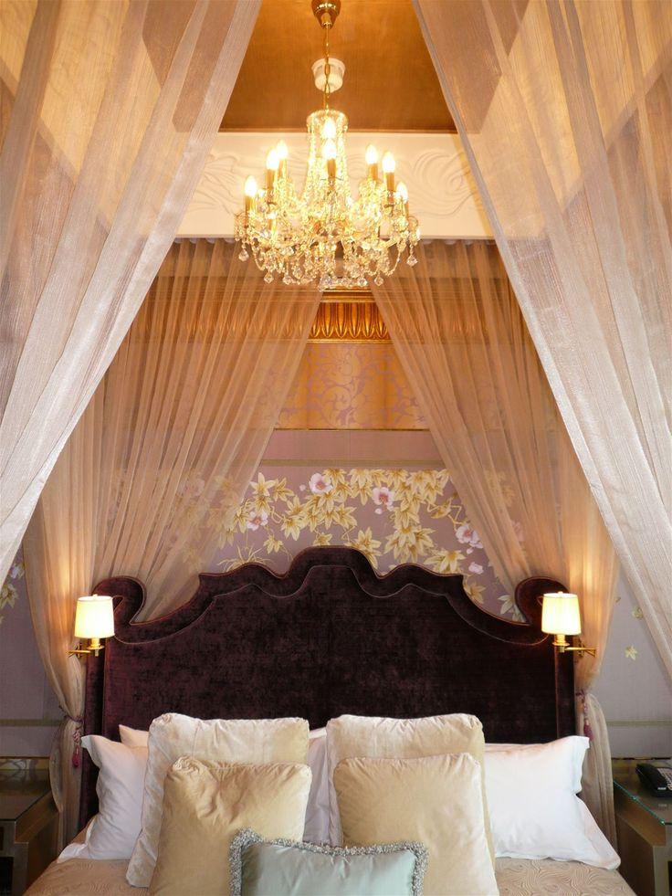 St Regis Hotel, Singapore. #bedroom #hotelroom #bed #lighting #design #oriental #lamps #chandelier #crystal #pillows