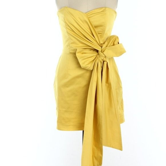"French Connection Yellow Sweetheart Bow Dress   Gorgeous, French Connection dress. Sweetheart neckline, deep yellow color. Flattering Gathered top that wraps to a big bow!  (My signature style: bows and pearls)!  Pristine condition, worn once, which price reflects! Back zip closure, with a pocket casual touch! Bust 32"", Waist 27"", Hips 38"", Length 25"". Dry clean only, 97% cotton, 3% Elastane. ❗️Runs small, equivalent to US size 0! Free gifts, 15% bundle discount. Tender loving care ❤️ Steph…"