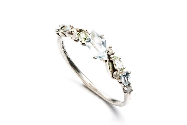 Why choose one gemstone when you can have the rainbow? Show your true colors with blue topaz, green amethyst, and grey diamonds.  #refinery29 http://www.refinery29.com/cheap-engagement-rings#slide-21