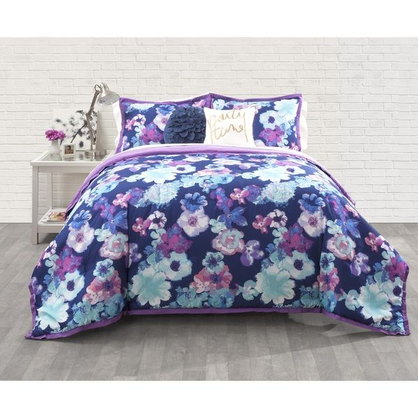 Give your bedroom a makeover with this fabulous three piece floral comforter set by Seventeen. This floral patterned bed set includes a comforter and shams to complete your bedding ensemble. With rich