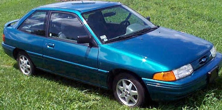 90s Ford Escort. my 4th car look just like this loved it ...