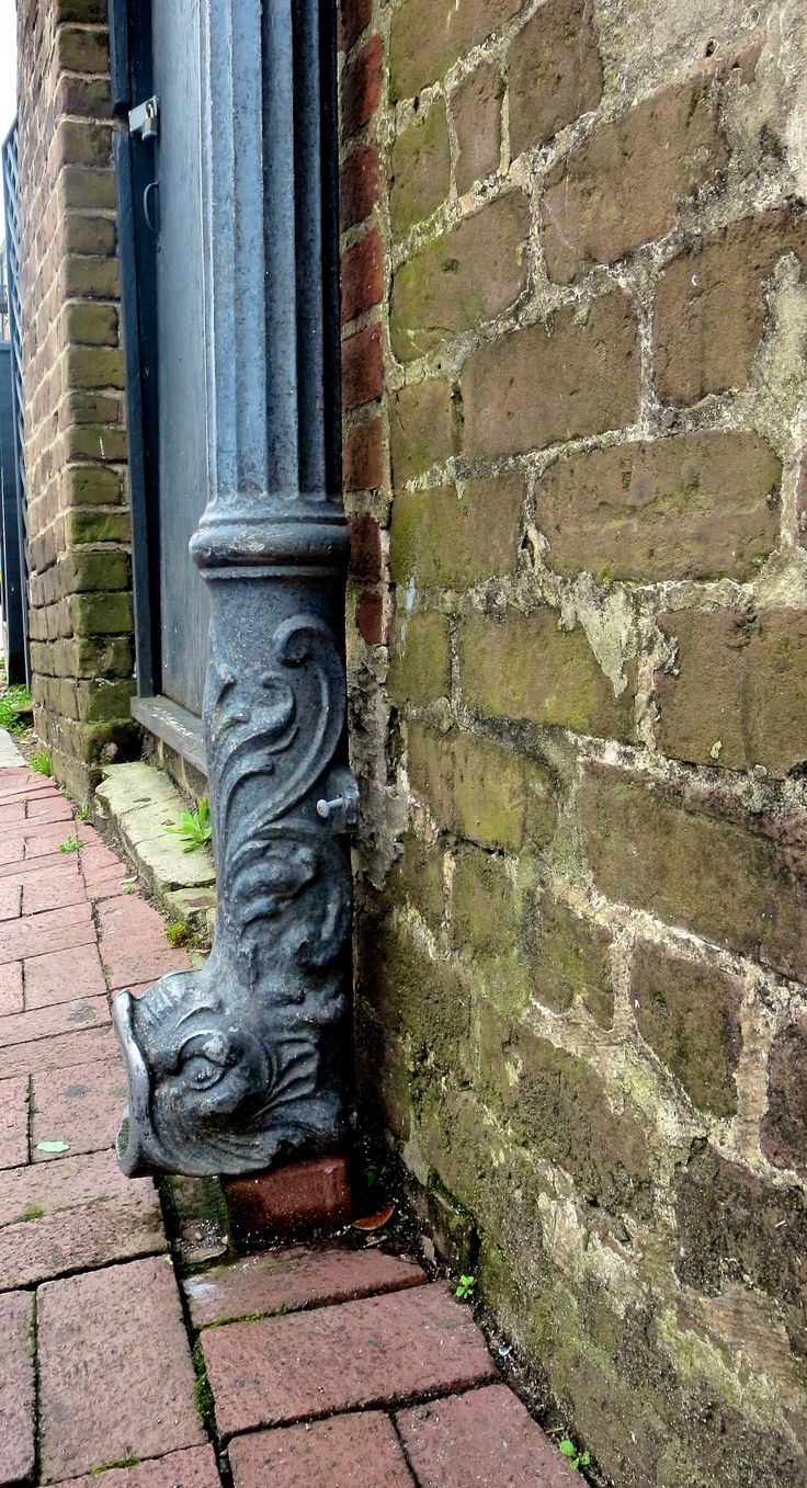 Decorative downspout on River Street, Savannah, GA.