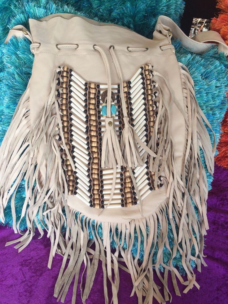 A personal favourite from my Etsy shop https://www.etsy.com/au/listing/210777047/lrg-cream-leather-fringe-bag