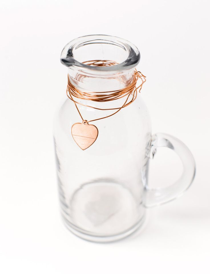 Glass Jug or Vase with Copper Heart Detailing. For table water or use as vases dotted around