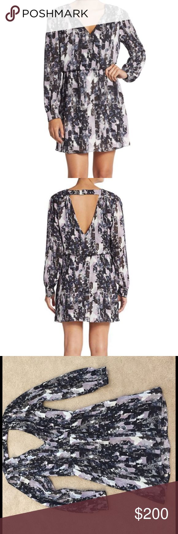 NWT Parker Lila Faux Wrap Dress NWT. 100% polyester. The bottom portion/skirt is lined. Open back with closure at the top (see picture). Just an absolutely beautiful dress. The cuffs on the sleeves button. Lavender floral print. Elastic waistband. **Sold Out online! Parker Dresses Mini
