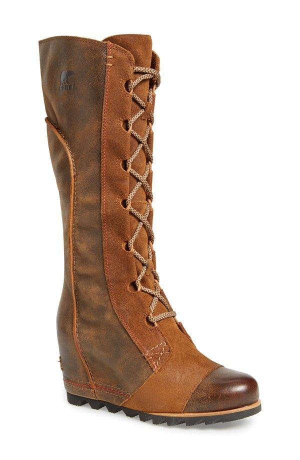 Hot Sorel winter boots for women: Cate the Great high lace-up boots. LOVE the height of these and the wedge heel gives you just enough lift.