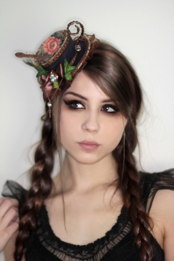 Teacup hat! and the hair and make up is perfect!