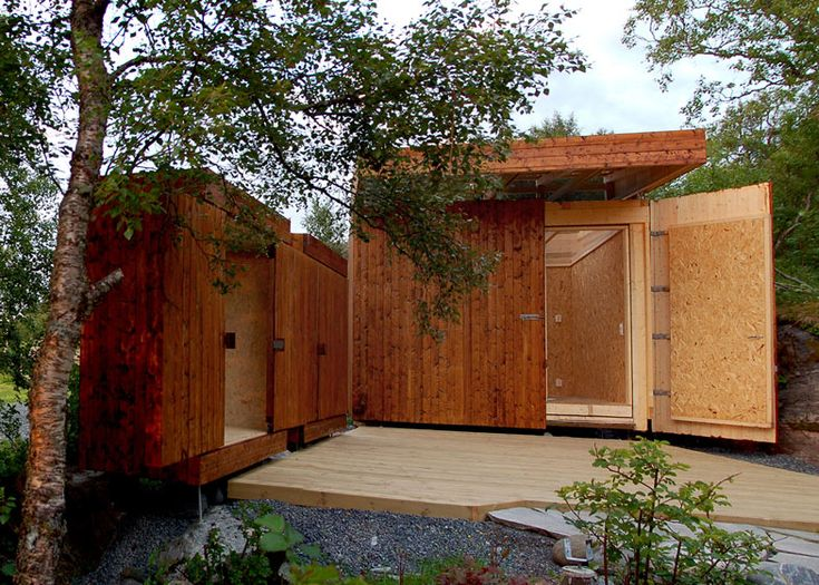 Wooden sheds by Rever & Drage with sliding doors and a retractable roof