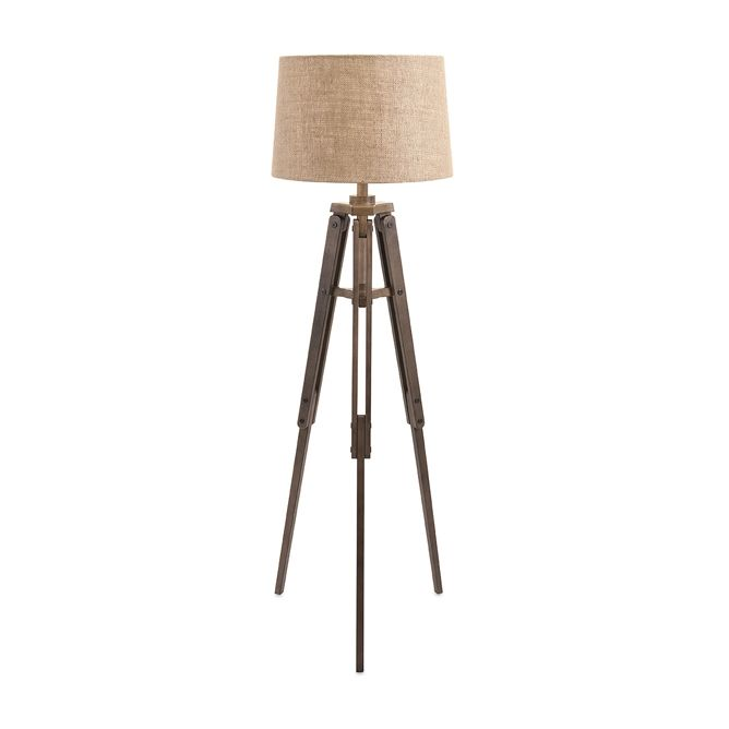 Bring a bit of the docks home with you—this rustic lamp radiates a vintage, nautical air. A riveted wooden tripod base and simple burlap shade give it style to spare.  Find the Shipyard Floor Lamp, as seen in the Our Favorite Industrial Designs Collection at http://dotandbo.com/collections/our-favorite-industrial-designs?utm_source=pinterest&utm_medium=organic&db_sku=99037