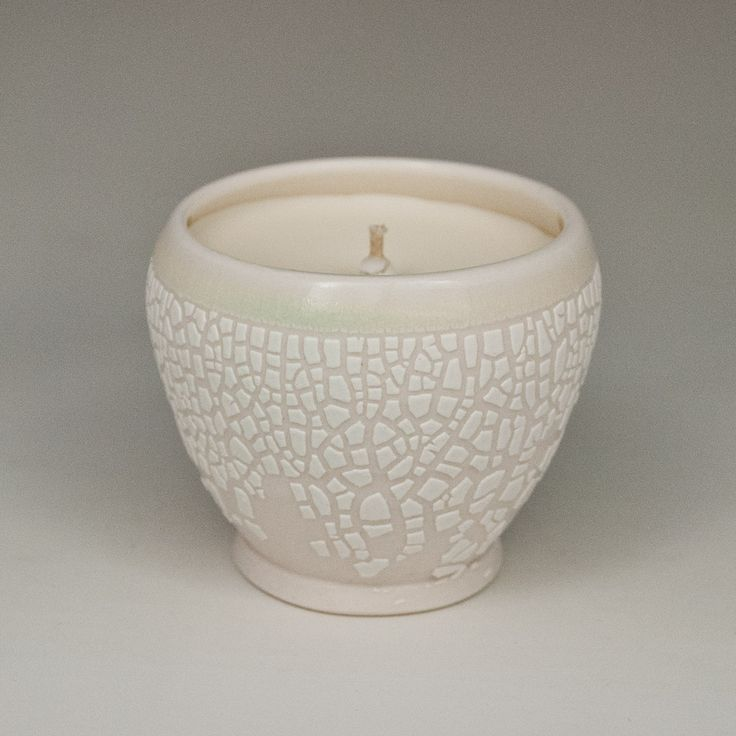 Wheel thrown translucent porcelain vessel filled with natural unscented soy wax An elegant creation combining two mediums clay and wax and two elements earth and fire The natural translucency of porcelain allows the candle light to shine through giving off a warm comforting glow When the