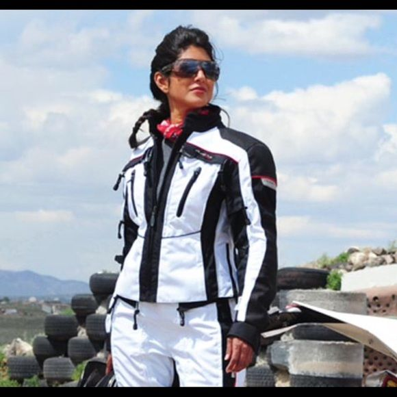 Women's motorcycle jacket size small Black & white This jacket is called expedition it's an all season transition jacket brand-new never worn no tags color combination is Ivory/black. It has a removable rain liner and insulation liner! The original price was $430 my price on this item is firm as it does not belong to me! For more information about this item please go to Olympiamotosportsdotcom. Item is marked so that it cannot be returned! Olympia moto sports Jackets & Coats Utility Jackets
