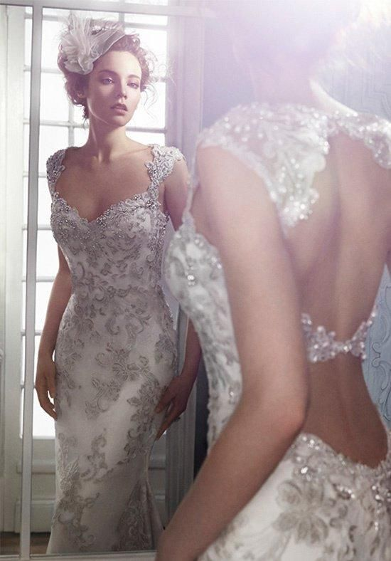 Exquisite bead embroidered lace adorns the bodice in this sheath wedding dress with Swarovski crystal neckline | Maggie Sottero | https://www.theknot.com/fashion/jade-maggie-sottero-wedding-dress