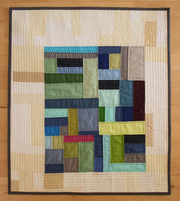 Solid color quilt, I like the island of color floating on the neutral background