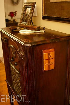 Oh my so awesome.  Old radio cabinet refurbished into ipod speakers.  Luuuuuuv!  Thats the ipod holder on the side.  Beautiful.  Loved seeing how they pieced it together.