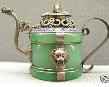 Tibet Silver Jade Armored Dragon Tea Pot. Wouldn't tea just seem lovely in this?