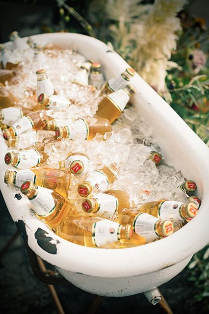 Using a vintage bathtub as a drink cooler is genius, but the bride's offbeat wedding dress is even better