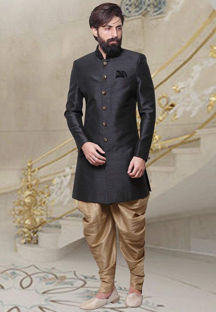 Readymade Art Silk Sherwani in Black This Plain attire is Enhanced with Buttons Available with a Beige Art Silk Dhoti Pant Do note: Footwear shown in the image is for presentation purposes only. Half to one inch may vary in measurement. (Slight variation in actual color vs. image is possible)