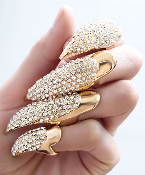 "Gold Crystal Claw Nail Rings gives a whole new meaning to the words ""scratch your eyes out"" !!! yowza..."